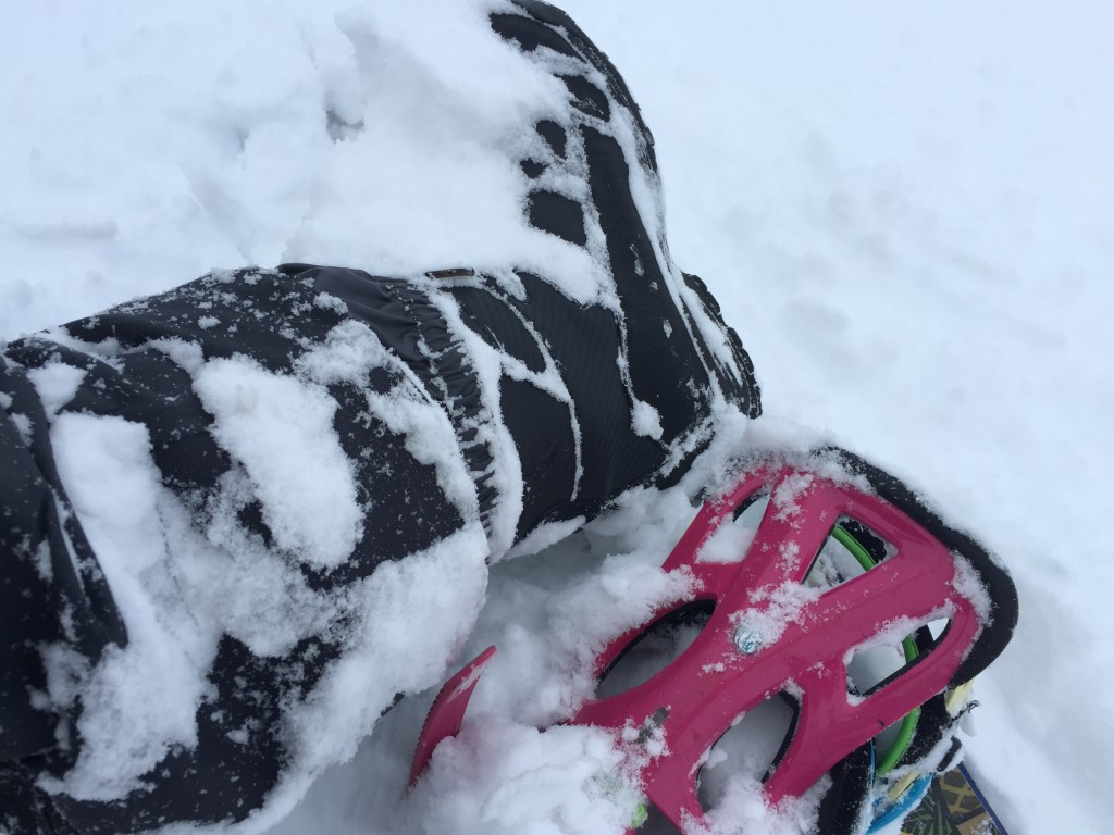 Walked in waist deep snow from my sled to the top of my snowboard lap and the cuff stayed tight.