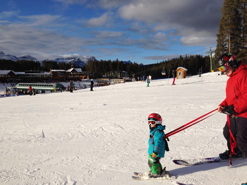 Learning to ski in the beginner area.