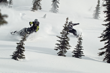 Dan Adams and Travis Rice play on the same slope.