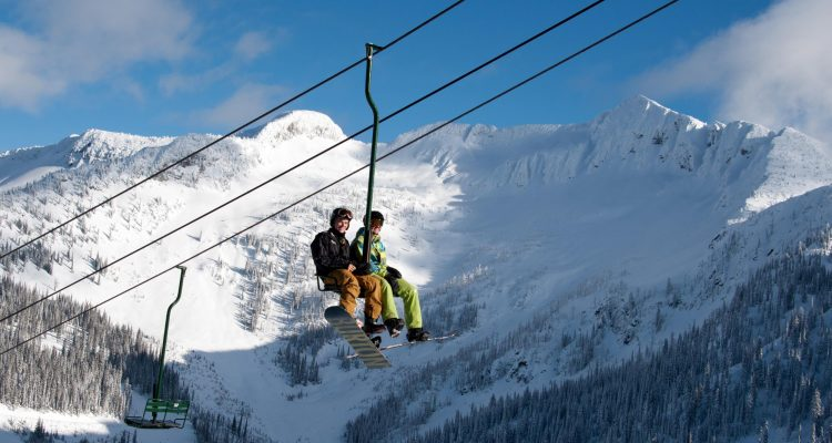 summit chair at Whitewater resort with Ymir peak in the background.